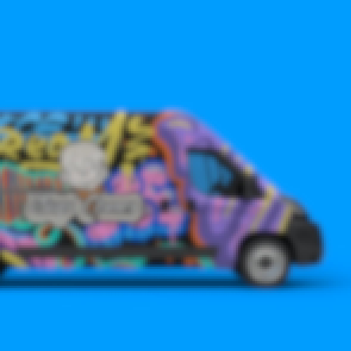 A van with grafitti on its exterior